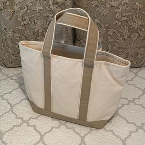 Tan and white canvas boat and tote bag